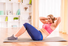 Fat woman dieting. Fitness and healthy food at home royalty free stock images