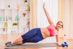 Fat woman dieting. Fitness and healthy food at home royalty free stock photo