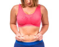 Fat woman dieting. The fat woman unhappy with her body isolated on white background Stock Images