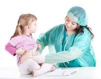 Fat woman doctor exam little girl Stock Photos