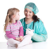 Fat woman doctor exam small young girl Stock Photography