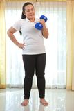 Fat woman does fitness with dumbbell Royalty Free Stock Photos