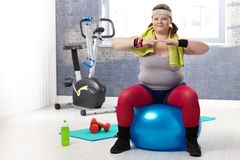 Fat woman doing gymnastics Stock Photography