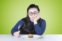 Fat woman feeling bored with potato Royalty Free Stock Image