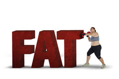 Fat woman fighting with fat word Stock Photos