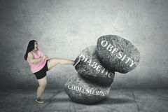 Fat woman fighting with her problem Royalty Free Stock Images