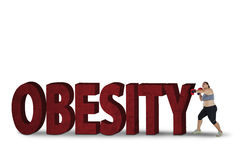 Fat woman fighting with obesity word Royalty Free Stock Images