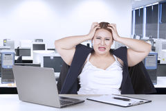 Fat woman frustration with her job Royalty Free Stock Photo