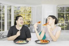 Fat woman with her friend at home Royalty Free Stock Photos