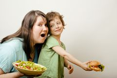 Fat Woman Holding Salad And Little Cute Boy With Stock Images