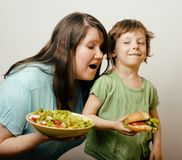 Fat woman holding salad and little cute boy with Stock Image