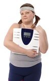 Fat woman holding a scale in hand Royalty Free Stock Images