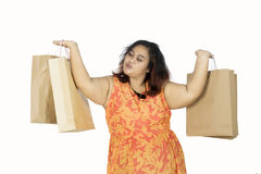 Fat woman holding shopping bags Royalty Free Stock Image