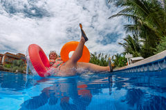 Fat woman is jumping splash into pool royalty free stock photography