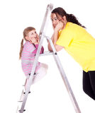 Fat woman and little girl with ladder Royalty Free Stock Image