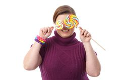 Fat woman with lollipops Royalty Free Stock Images