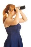 Fat woman looking through binoculars Stock Photography