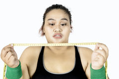Fat woman looking measuring tape Stock Photo