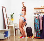 Fat woman with luggage Stock Image