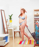 Fat woman with luggage Stock Photo