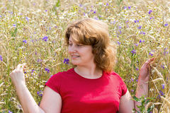 Fat woman  in  meadow Stock Photos