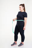 Fat woman measuring her waist Royalty Free Stock Images