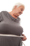 Fat woman measuring waist Stock Photography