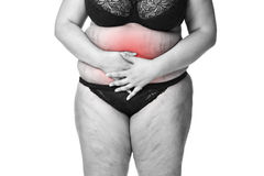 Fat woman with menstrual pain, endometriosis or cystitis, stomach ache, overweight female body isolated on white background Royalty Free Stock Image