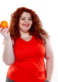 The fat woman with orange juice vegetable fruit holding isolated Stock Image