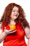 The fat woman with orange juice vegetable fruit holding isolated Royalty Free Stock Photography