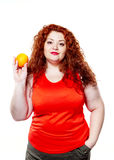 The fat woman with orange juice vegetable fruit holding isolated Stock Images