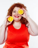 The fat woman with orange juice vegetable fruit holding isolated Royalty Free Stock Photos