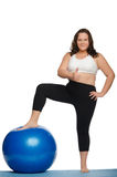 Fat woman with overweight and blue ball Royalty Free Stock Photos