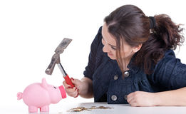 Fat woman with pink piggy bank Royalty Free Stock Photography