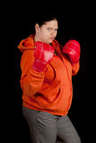 Fat woman and red boxing gloves Stock Photo