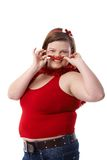 Fat woman in red at Christmas smiling Royalty Free Stock Image