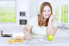 Fat woman refuses fast food Royalty Free Stock Images