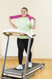 Fat Woman Running Treadmill Royalty Free Stock Images