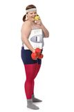 Fat woman with scale green apple and dumbbells Royalty Free Stock Images