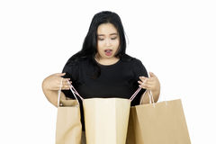 Fat woman shocked with shopping bags Stock Image