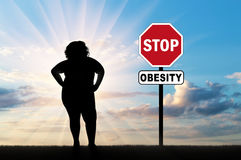 Fat woman and a sign of stop obesity Stock Image