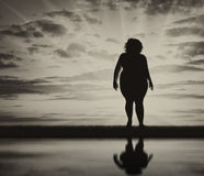 Fat woman silhouette and reflection Royalty Free Stock Photos