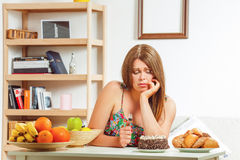 Free Fat Woman Sitting At Table Home Stock Photos - 73235613