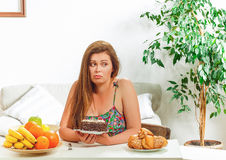 Free Fat Woman Sitting At Table Home Royalty Free Stock Photography - 73236457