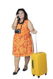 Fat woman with a smartphone. Full length of fat woman ready to vacation while speaking on a smartphone, isolated on white background Stock Photos
