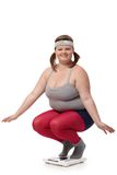 Fat woman smiling on scale royalty free stock images