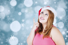 Fat woman thinking about her christmas holiday Royalty Free Stock Photography