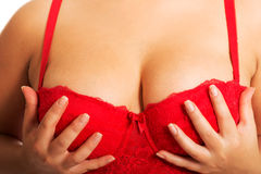 Fat woman touching her breast wearing bra Stock Photos
