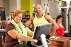 Fat woman training with personal trainer Stock Image