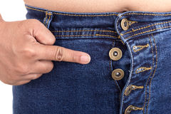 Fat woman trying to wear jeans : Fat and Healthy concept Royalty Free Stock Photography